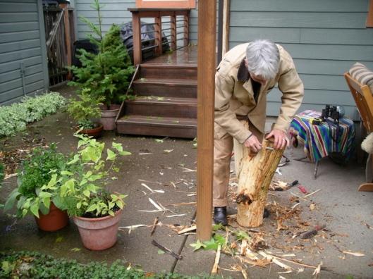 Kristin Kuhns peels the bark